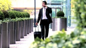 stock-footage-young-city-businessman-preparing-to-travel-from-city-airport